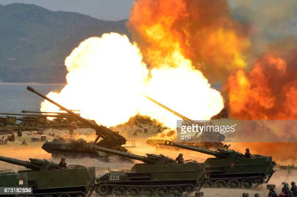 TOPSHOT This undated picture released by North Korea's official Korean Central News Agency on April 26 2017 shows the combined fire demonstration of...