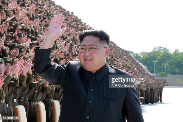 This undated picture released by North Korea's official Korean Central News Agency on September 2 2017 shows North Korean leader Kim JongUn attending...
