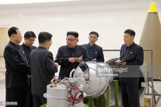 This undated picture released by North Korea's official Korean Central News Agency on September 3 2017 shows North Korean leader Kim JongUn looking...