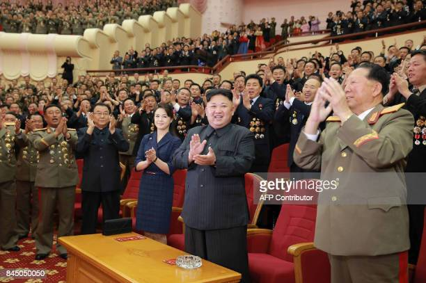 This undated picture released by North Korea's official Korean Central News Agency on September 10 2017 shows North Korean leader Kim JongUn and his...