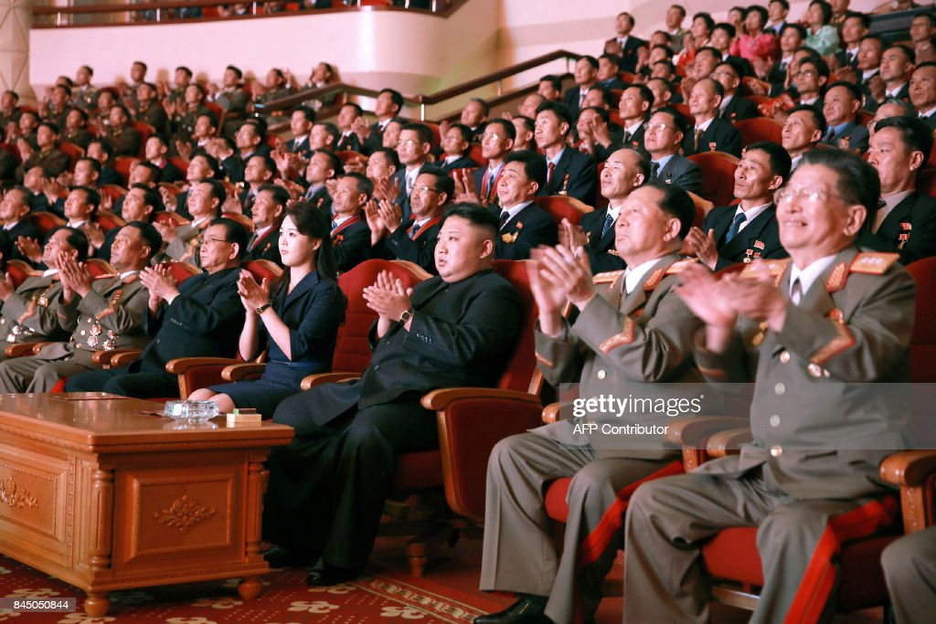 This undated picture released by North Korea's official Korean Central News Agency (KCNA) on September 10, 2017 shows North Korean leader Kim Jong-Un (front C) and his wife Ri Sol-Ju (front 4th L) attending an art performance dedicated to nuclear scientists and technicians, who worked on a hydrogen bomb which the regime claimed to have successfully tested, at the People's Theatre in Pyongyang. / AFP PHOTO / KCNA VIA KNS / STR / South Korea OUT / REPUBLIC OF KOREA OUT ---EDITORS NOTE--- RESTRICTED TO EDITORIAL USE - MANDATORY CREDIT 'AFP PHOTO/KCNA VIA KNS' - NO