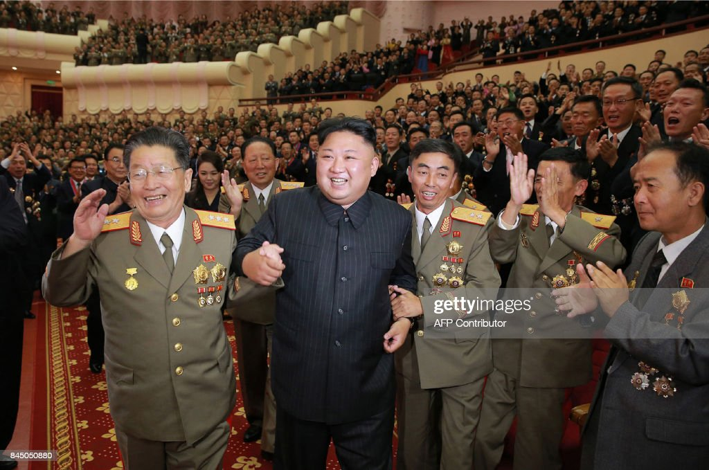 This undated picture released by North Korea's official Korean Central News Agency (KCNA) on September 10, 2017 shows North Korean leader Kim Jong-Un (front 2nd L) attending an art performance dedicated to nuclear scientists and technicians, who worked on a hydrogen bomb which the regime claimed to have successfully tested, at the People's Theatre in Pyongyang. / AFP PHOTO / KCNA VIA KNS / STR / South Korea OUT / REPUBLIC OF KOREA OUT ---EDITORS NOTE--- RESTRICTED TO EDITORIAL USE - MANDATORY CREDIT 'AFP PHOTO/KCNA VIA KNS' - NO