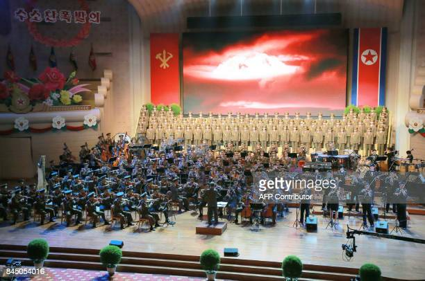 This undated picture released by North Korea's official Korean Central News Agency on September 10 2017 shows a performance dedicated to nuclear...