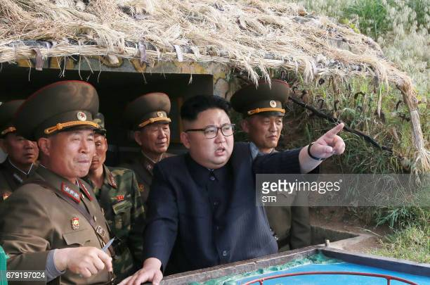 This undated picture released from North Korea's official Korean Central News Agency on May 5 2017 shows North Korean leader Kim JongUn inspecting...