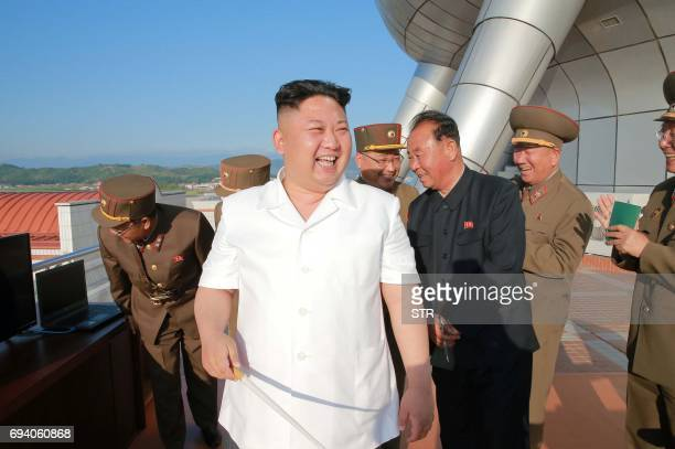 This undated picture released from North Korea's official Korean Central News Agency on June 9 2017 shows North Korean leader Kim JongUn inspecting a...