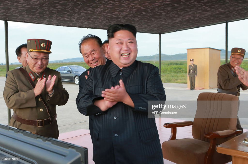 This undated picture released from North Korea's official Korean Central News Agency (KCNA) on September 16, 2017 shows North Korean leader Kim Jong-Un (C) inspecting a launching drill of the medium-and-long range strategic ballistic rocket Hwasong-12 at an undisclosed location. Kim vowed to complete North Korea's nuclear force despite sanctions, saying the final goal of his country's weapons development is 'equilibrium of real force' with the United States, state media reported on September 16. / AFP PHOTO / KCNA VIA KNS / STR / South Korea OUT / REPUBLIC OF KOREA OUT ---EDITORS NOTE--- RESTRICTED TO EDITORIAL USE - MANDATORY CREDIT 'AFP PHOTO/KCNA VIA KNS' - NO