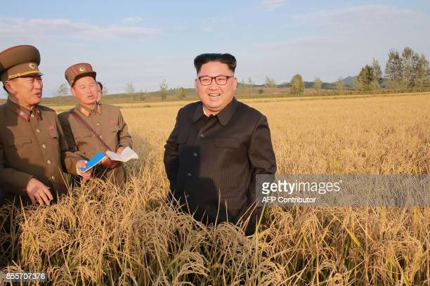This undated picture released from North Korea's official Korean Central News Agency on September 30 2017 shows North Korean leader Kim JongUn...