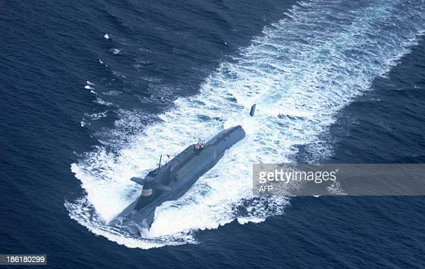 This undated picture shows a nuclearpowered submarine of the People's Liberation Army Navy's North Sea Fleet preparing to dive into the sea Beijing...