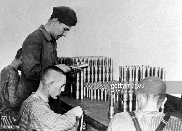 This undated picture shows prisoners of the Dachau concentration camp producing parts for weapons Germany's chief negotiator on compensation for...