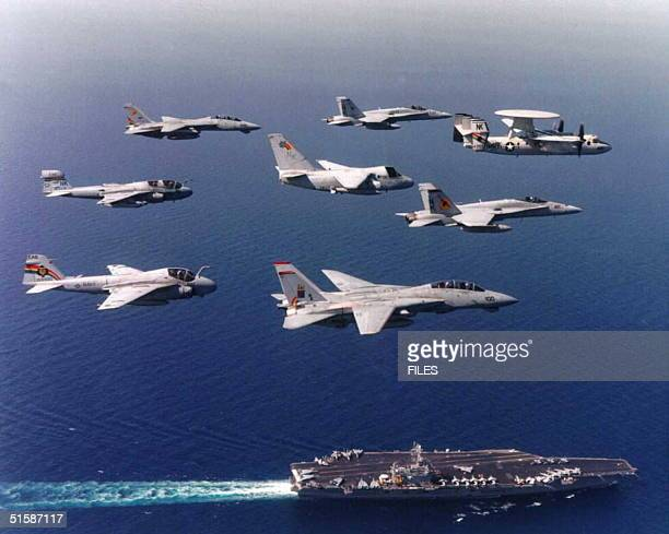 This undated recent photo provided by the US Navy shows the nuclear powered aircraft carrier USS Carl Vinson which has a crew and airwing of nearly...