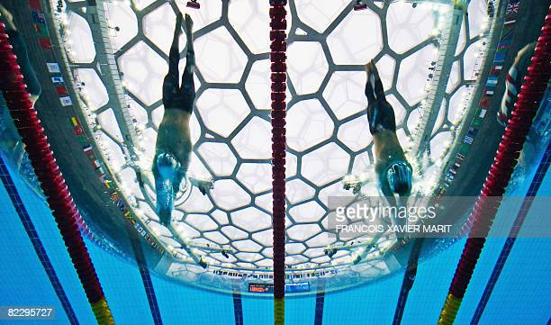 This underwater photograph shows Japan's Kosuke Kitajima and Canada's Mike Andrew Brown competing during the men's 200m breaststroke swimming final...
