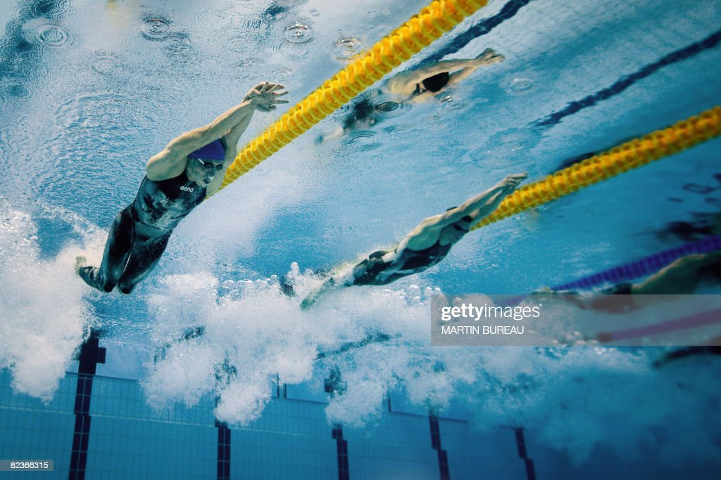 this underwater photograph shows russias yuriy prilukov l and canadas ryan cochrane competing during - Olympic Swimming Underwater