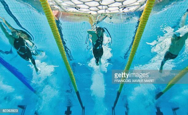 This underwater photograph shows US swimmer Michael Phelps South Korea's Park Taehwan and Japanese swimmer Yoshihiro Okumura during the men's 200m...
