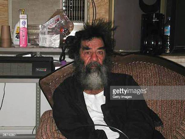 This unsourced picture alleges to show Iraqi leader Saddam Hussein in an unknown location in Iraq after his capture by US troops on December 13 2003...