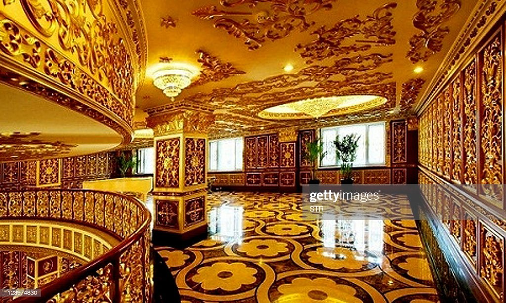 This updated photo received on September 7, 2011 shows the luxury interior decoration of the office building, containing three floors of offices and three more floors of a print museum belonging to the state-owned Harbin Pharmaceutical Group Sixth factory in Harbin, in northeast China's Heilongjiang province. The state-owned drug firm in China has caused online outrage for allegedly building offices that appear to mimic France's Versailles palace, complete with gold-tinted walls and chandeliers. CHINA
