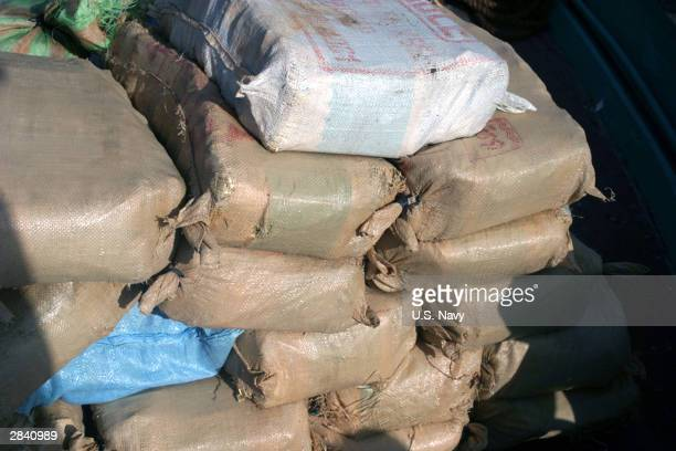 This US Navy handout photo shows over 2800 pounds of narcotics believed to be hashish upon inspection of a dhow suspected of drug trafficking seized...