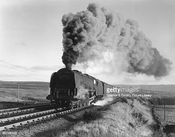 This very dirty London Midland Scottish Coronation Class locomotive No 46233 climbs Shap Bank with an express train Photograph by Bishop Eric Treacy...