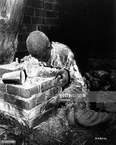 This victim of Nazi inhumanity still rests in the position in which he died attempting to rise and escape his horrible death He was one of 150...