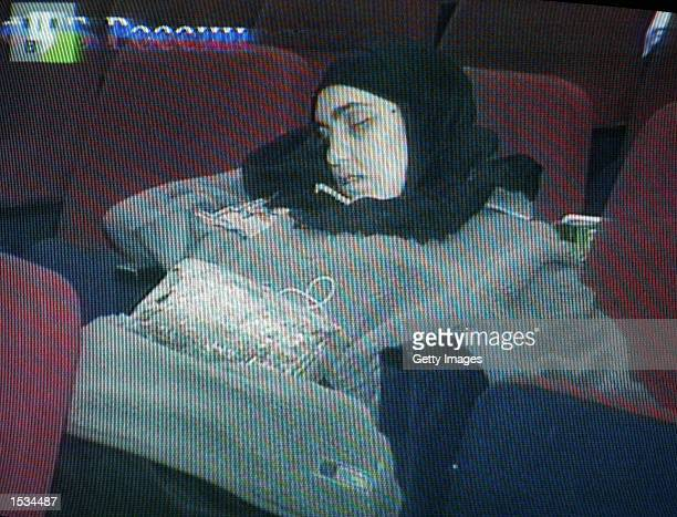 This video capture from Russian television shows a dead female Chechen rebel inside the theater where hundreds hostages were held by the rebels...