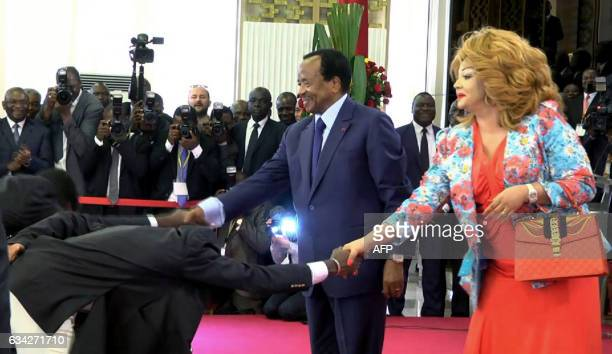 This video grab image created on February 8 2017 shows Cameroonian national football team players perform a 'deep bow' to President Paul Biya and his...