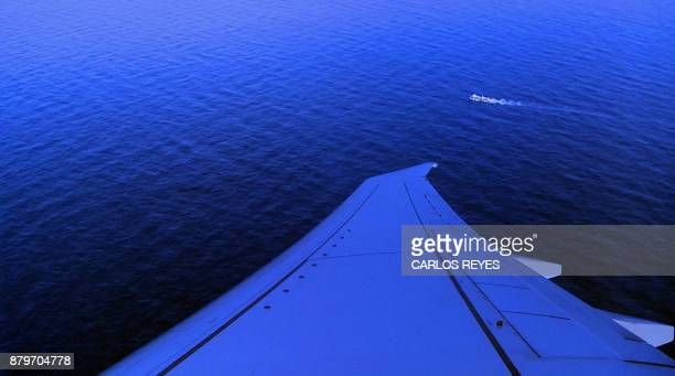 This video grab shows a ship sailing the Argentine Sea seen from the P8A Poseidon aircraft of the US Navy Patrol and Reconnaissance Wing 11 assisting...