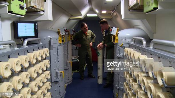 This video grab shows members of the US Navy Patrol and Reconnaissance Wing 11 on a P8A Poseidon aircraft assisting the Argentine military in their...