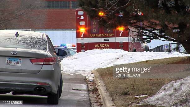 This video grab shows police officers guarding the area where a gunman opened fire in an industrial area in Aurora Illinois on February 15 2019 Five...