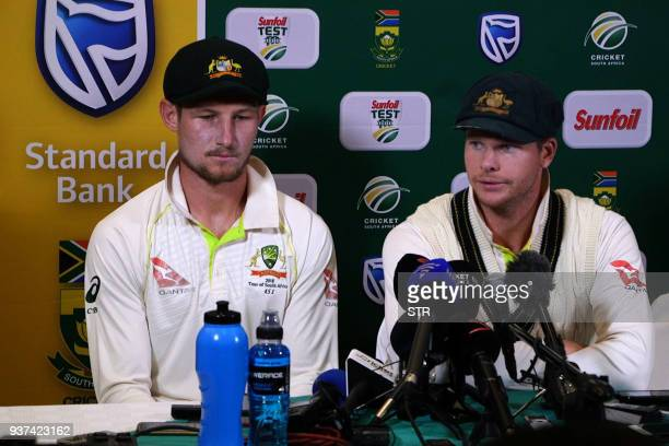 TOPSHOT This video grab taken from a footage released by AFP TV shows Australia's captain Steve Smith flankled by teammate Cameron Bancroft speaking...