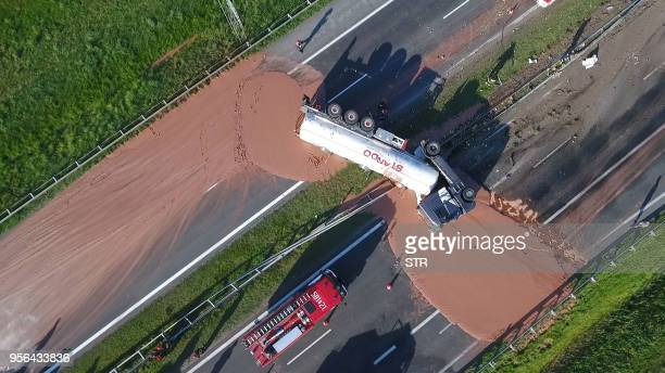 This video grab taken from Polish private TVN channel shows hot chocolate poured out over the A2 highway between Wrzesnia and Slupca near Poznan...