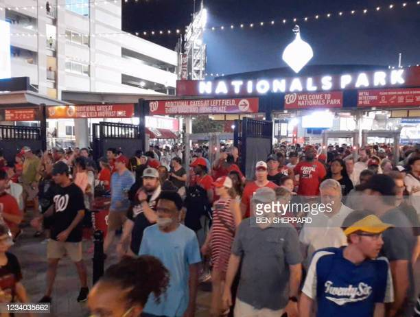 This video screen grab shows people leaving the Nationals Park stadium as the game between the Washington Nationals and the San Diego Padres was...