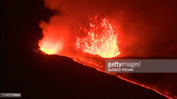 This videograb released by AFPTV shows the Mount Etna Europe's biggest active volcano erupting on May 31 2019 near Catania due to the opening of two...