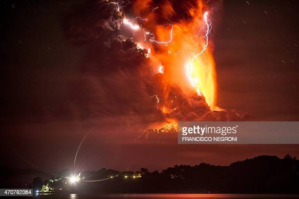 This view from Frutillar, southern Chile, shows a high column of ash and lava spewing from the Calbuco volcano, on April 23, 2015. Chile's Calbuco...