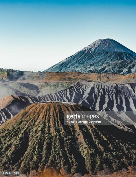 this view is at mount bromo which shows bukit widodaren and mount semeru - bromo tengger semeru national park stock pictures, royalty-free photos & images