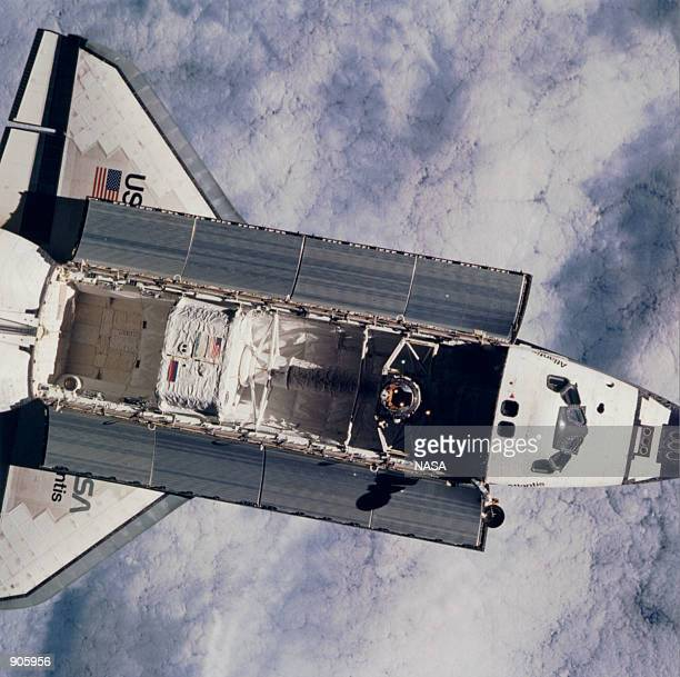 This view of the Space Shuttle Atlantis was taken by the two Mir-21 cosmonaut crew members onboard Russia's Mir space station, during rendezvous and...