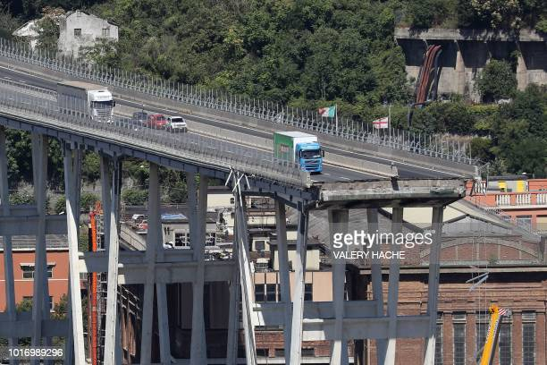 This view taken on August 15 shows abandoned vehicles on the Morandi motorway bridge the day after a section collapsed in the northwestern Italian...