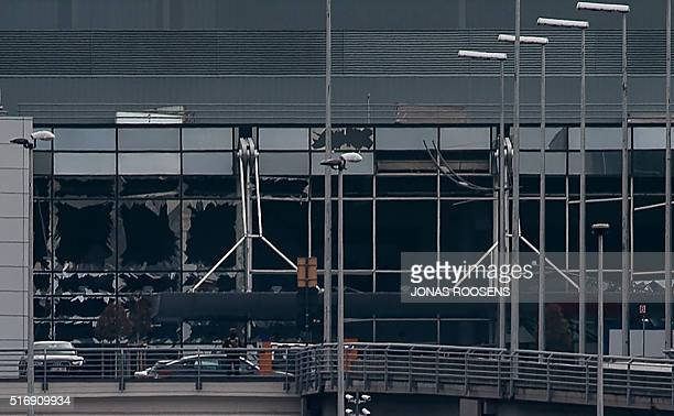This view taken on March 22 2016 shows the broken glasses at Brussels Airport in Zaventem after a two explosions targeted the main hall A string of...