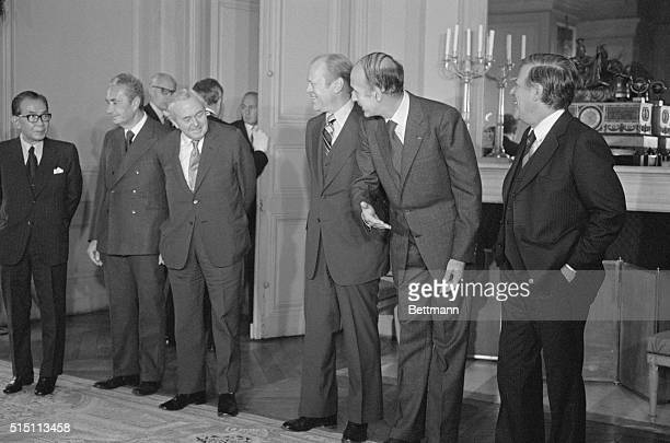 French President Giscard D' Estaing invites Prime Minister Harold Wilson to move in closer for 'La Photo de Famille' Japan's Takeo Miki Italy's Aldo...