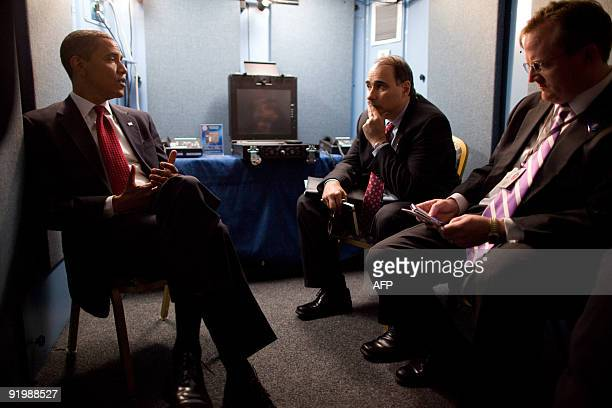This White House handout photo shows US President Barack Obama as he confers with Senior Advisor David Axelrod and Press Secretary Robert Gibbs after...