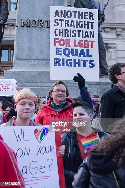 CONTENT] This woman held a sign reading Another Straight Christian for LGBT Equal Rights at the United for Marriage Light the Way to Justice on the...