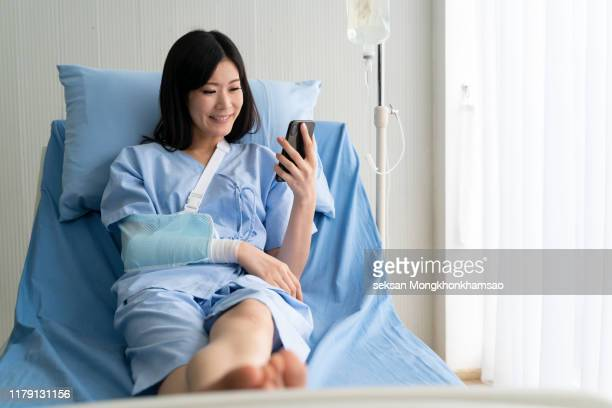 this woman, she has recovered from illness, is able to play the phone and is very happy - infused stock pictures, royalty-free photos & images