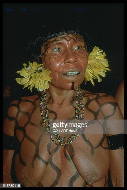 This Yanomami woman has put on her best feathers and necklaces and painted her body for the Rehao ceremony The dead will be honored in singing and...