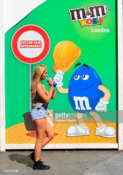 CONTENT] This youg lady is passing a billboard for a large store in Picadilly London The poster refers to the fact that the store is undergoing...