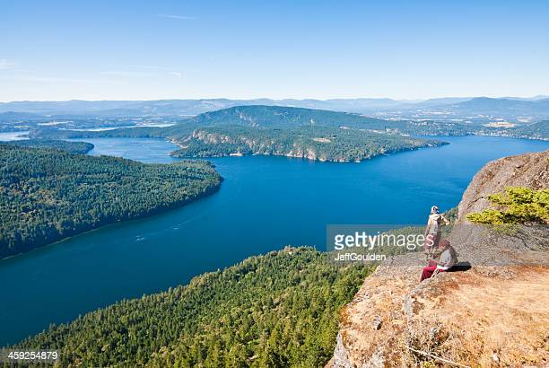Couple Sitting on a Rock Ledge