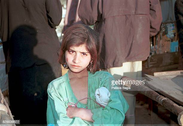 This young girl is among the estimated 175000 refugees who has fled from neighboring Afghanistan to the Peshawar region of Pakistan to escape the...