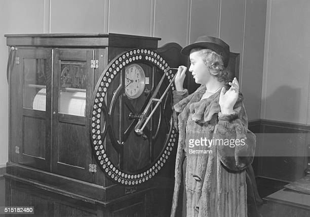 This young lady, a switchboard operator, has a little difficulty getting to work on time. Here she is punching in at 9:40 a.m., 40 minutes late, but...