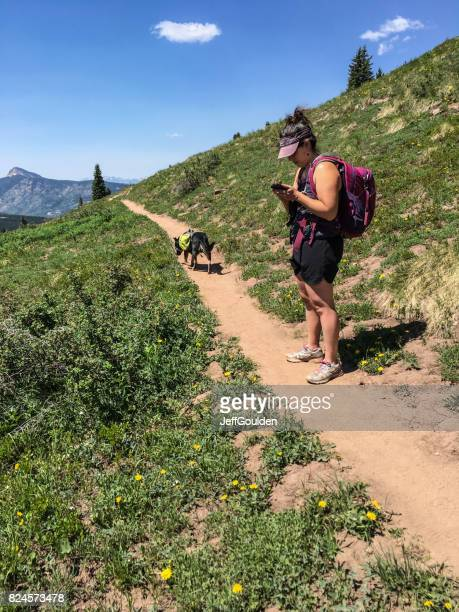 Young Woman Hiker Checking Her Smart Phone