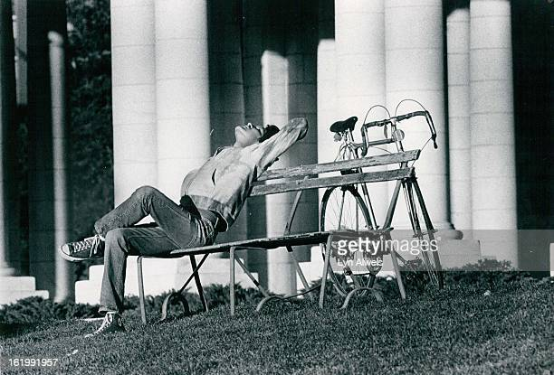 DAY This youth seems to be worshipping the sun as he relaxes on a bench in Cheesman Park Thursday afternoon as Denver's weather took a turn for the...