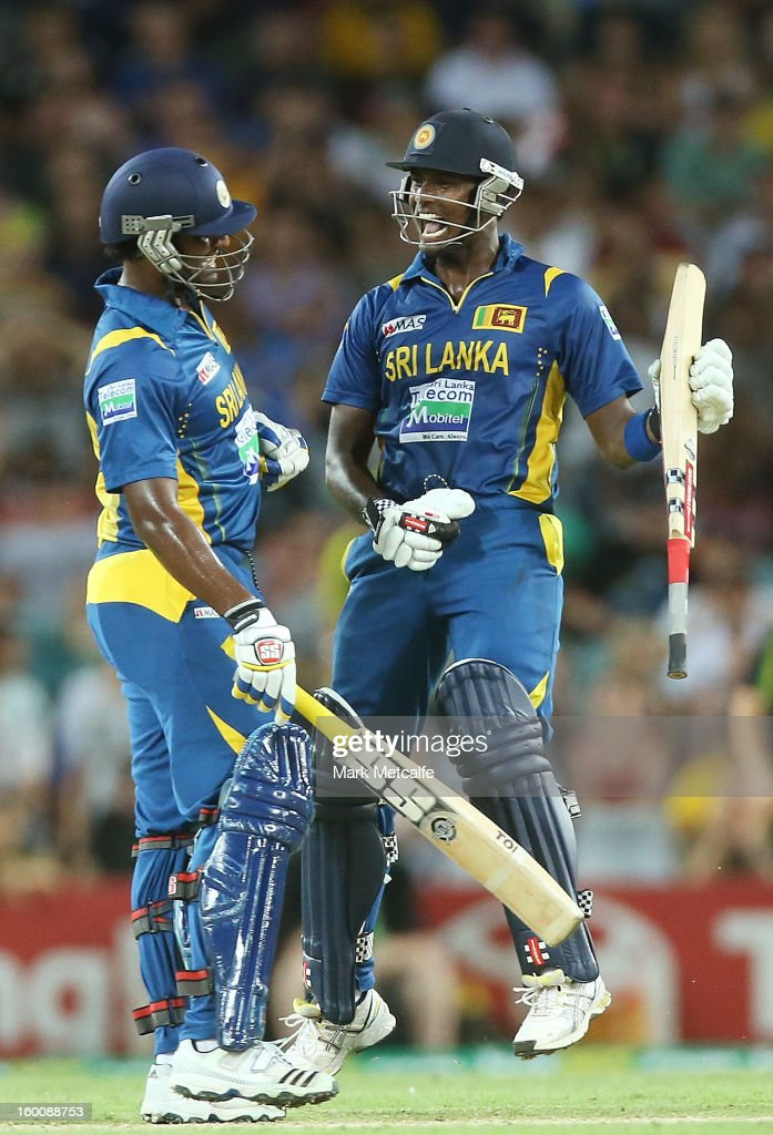 Thisara Perera and Angelo Mathews of Sri Lanka celebrate victory at the end of game one of the Twenty20 international match between Australia and Sri Lanka at ANZ Stadium on January 26, 2013 in Sydney, Australia.
