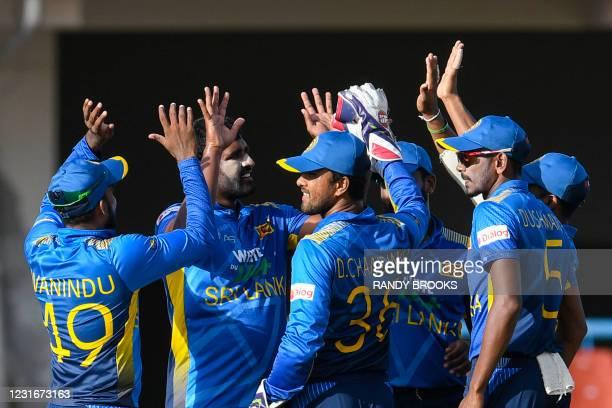 Thisara Perera , Dinesh Chandimal and Dushmantha Chameera of Sri Lanka celebrate the dismissal of Shai Hope of West Indies during the 2nd ODI match...