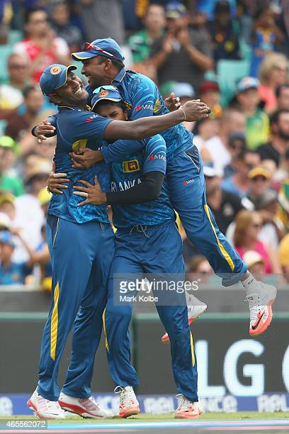 Thisara Perera Dinesh Chandimal and Mahela Jayawardene of Sri Lanka celebrate after Perera took the catch to dismiss Steve Smith of Australia during...